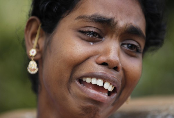 Vasantha cries outside her house after her husband was picked up by police for allegedly participating in a protest against the Kudankulam Atomic Power Project in Kudankulam, about 440 miles south of Chennai, Tamil Nadu state, India on Wednesday, Sept. 12, 2012. One person was killed Monday after police fired at protestors demonstrating against the loading of nuclear fuel in the Russian-built reactor. Construction of the plant has been delayed by protests in the past year by residents and anti-nuclear groups concerned about safety following the Fukushima nuclear power plant disaster in Japan last year.