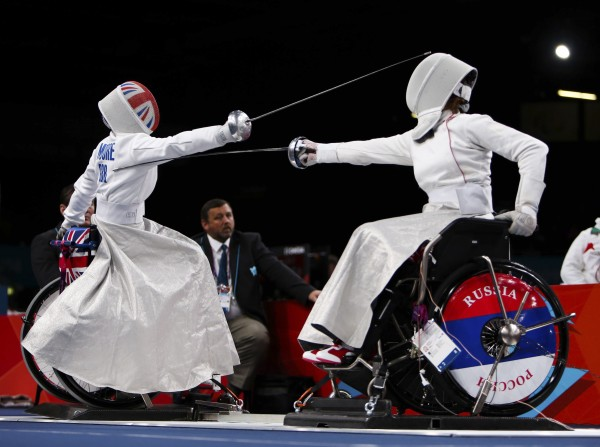 Great Britain's Justine Moore (left) competes against Russia's Liudmila Vasileva during the Paralympic women's individual Epee Category B Preliminary Pool B at the Excel Arena, London, Wednesday Sept. 5, 2012.