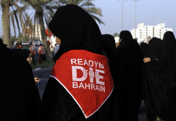 Bahraini anti-government protesters gather for a march of thousands calling for democracy in the Gulf island kingdom along a main highway outside Manama, Bahrain, on Friday, Sept. 14, 2012.