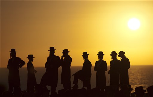 Ultra-Orthodox Jews of the Hassidic sect Vizhnitz gather on a hill overlooking the Mediterranean sea as they participate in a Tashlich ceremony in Herzeliya, Israel on Monday, Sept. 24, 2012. Tashlich, which means &quotto cast away&quot in Hebrew, is the practice by which Jews go to a large flowing body of water and symbolically &quotthrow away&quot their sins by throwing a piece of bread, or similar food, into the water before the Jewish holiday of Yom Kippur, which starts Tuesday.