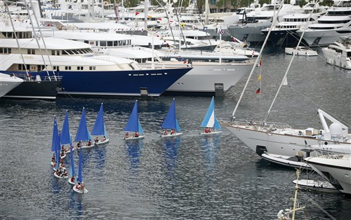 A sailing school sails in the middle of the yachts showing in the 23rd edition of the Monaco Yacht Show on Wednesday, Sept. 19, 2012, in Monaco. The Monaco Yacht Show, taking place at Port Hercules in Monaco, is the only boat show devoted exclusively to luxury yachting.