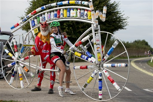 Professional cyclist Kathryn Bertine (right) of Saint Kitts and Nevis poses with cycling fan and bicycle constructor Didi Senft of Germany on the course of the road race of the Road World Championship Cycling near Valkenburg, southern Netherlands, Thursday Sept. 20, 2012.