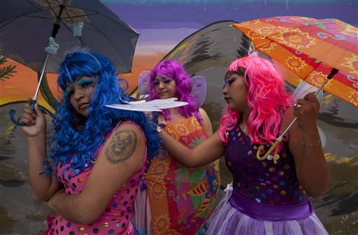 Female inmates wearing butterfly costumes attend an event that celebrates the first days of Spring at a prison for women in Lima, Peru on Monday, Sept. 24, 2012.  The event is part of a program that aims to help prisoners reduce stress and build self-confidence.