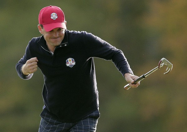 USA's Keegan Bradley reacts after making a putt to win the hole during a foursomes match at the Ryder Cup PGA golf tournament Friday, Sept. 28, 2012, at the Medinah Country Club in Medinah, Ill.