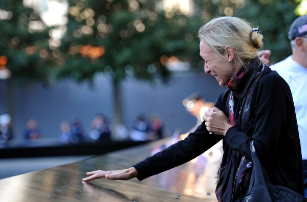 Carrie Bergonia remembers her fiancee, firefighter Joseph Ogren, who was killed in the terrorist attacks of Sept. 11, 2001, during a ceremony marking the 11th anniversary of the attacks at the National September 11 Memorial at the World Trade Center site in New York on Tuesday, Sept. 11, 2012.