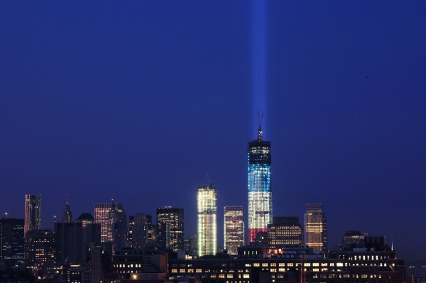 The Tribute in Light rises from behind 1 World Trade Center, now up to 105 floors, Wednesday, Sept. 12, 2012 in New York. Also under construction is 4 World Trade Center (center).