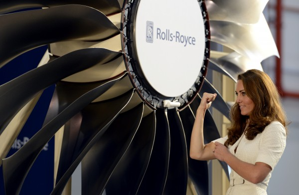 Britain's Kate, the Duchess of Cambridge, flexes her biceps after pushing in the last blade of a Rolls-Royce wide chord fan blade during her tour of the Rolls-Royce Seletar Campus on Wednesday, Sept. 12, 2012,  in Singapore. Prince William, the Duke of Cambridge and his wife Kate were the guests of honor at the official unveiling ceremony of the first Rolls-Royce Wide Chord Fan Blade and Trent aero engine to be produced in Singapore.