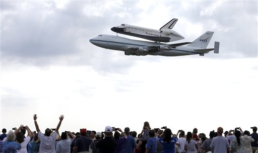 Space shuttle Endeavour flies over Ellington Field in Houston atop the shuttle aircraft carrier Wednesday, Sept. 19, 2012. Endeavour is making a final trek across the country to the California Science Center in Los Angeles, where it will be permanently displayed.
