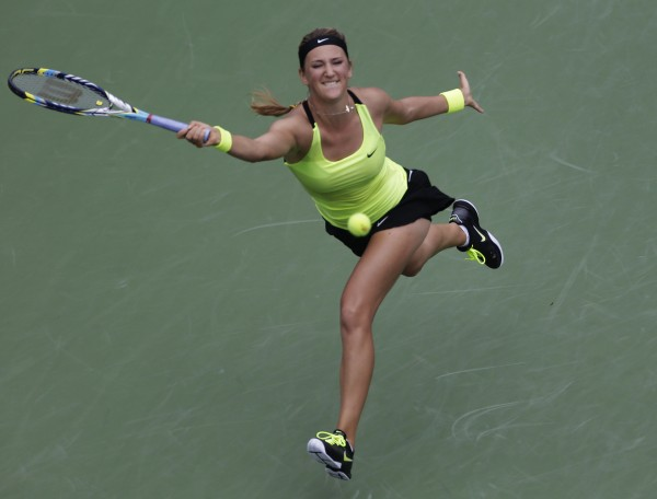 Victoria Azarenka, of Belarus, returns a shot to Samantha Stosur, of Australia, in the quarterfinals of the 2012 US Open tennis tournament, Tuesday, Sept. 4, 2012, in New York.