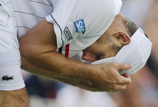 Andy Roddick reacts during his match with Argentina's Juan Martin Del Potro in the quarterfinals of the 2012 U.S. Open tennis tournament, Wednesday, Sept. 5, 2012, in New York.