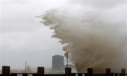 High waves crash over the sea wall on to an avenue during a heavy wind storm in Montevideo, Uruguay, Wednesday, Sept. 19, 2012. A powerful storm blew across the southern cone of South America, breaking windows in several buildings in Uruguay's capital, toppling about a hundred trees and cutting off three highways due to flooding.