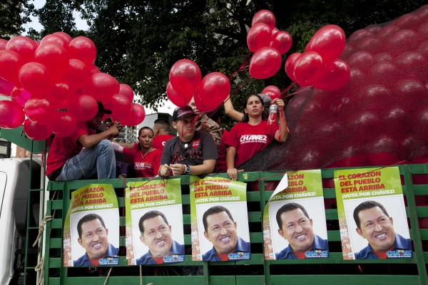 Supporters of Venezuela's President Hugo Chavez stand in a trailer bed as they take part in a campaign caravan through the streets of Caracas, Venezuela, Friday, Sept. 28, 2012. Venezuela's presidential election is scheduled for Oct. 7.
