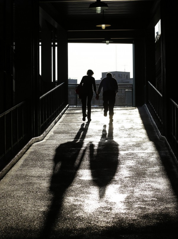 Two fans walk up a ramp to enter Fenway Park's seating areas before a baseball game between the Boston Red Sox and the New York Yankees at Fenway Park in Boston on Wednesday, Sept. 12, 2012.