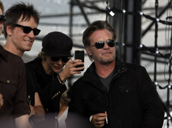 Performer John Mellencamp (right) and actress Meg Ryan (center) watch Dale Watson perform at the start of  Farm Aid 2012 concert at Hersheypark Stadium in Hershey, Pa., Saturday, Sept. 22, 2012.