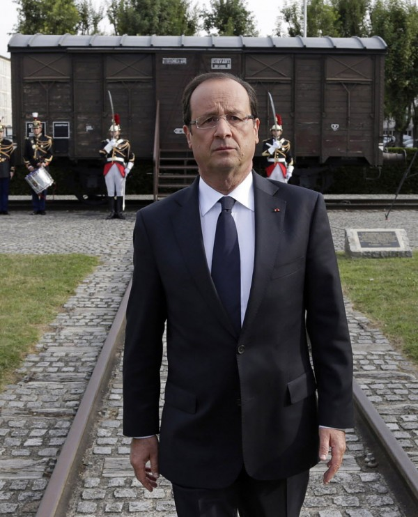 French President Francois Hollande walks back from the train car symbolizing the Drancy camp, during the inauguration of the new Shoah memorial in Drancy, a Paris suburb, Friday, Sept. 21, 2012. France has inaugurated a memorial to tens of thousands of Jews forced into a World War II internment camp that was set up with cooperation from the Nazi collaborationist Vichy government.