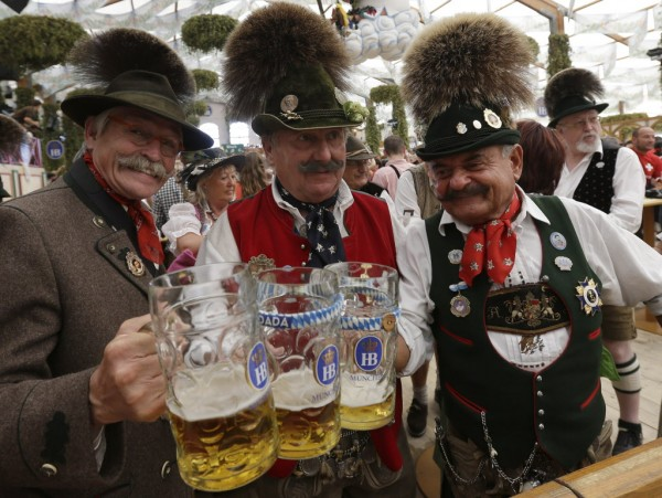 Traditionally dressed Bavarian men raise their steins and enjoy a sunny day of the famous Bavarian &quotOktoberfest&quot beer festival in Munich, southern Germany, Tuesday, Sept. 25, 2012. The world's largest beer festival, to be held from Sept. 22 to Oct. 7, 2012, will see some million visitors.