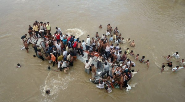 Locals and rescuers search for survivors after a bus fell into the Purna River in the Buldhana district of Maharashtra state, about 400 miles north of state capital Mumbai, India, Wednesday, Sept. 26, 2012. Police say 17 people died when the bus they were traveling in plunged into the river in western India. India has the world's highest road death toll, with more than 110,000 people dieing in road accidents each year.