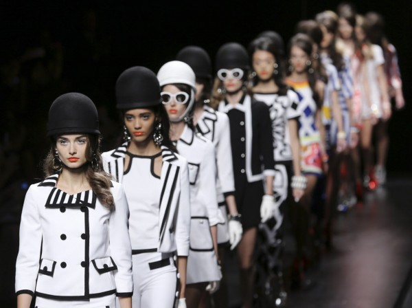 Models wear creations part of the Moschino women's Spring-Summer 2013 fashion collection, during the fashion week in Milan, Italy, on Friday, Sept. 21, 2012.