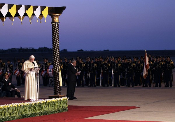 Pope Benedict XVI addresses a speech in front of Lebanese honor guards during his departure ceremony at Rafik Hariri International airport in Beirut, Lebanon, Sunday Sept. 16, 2012. Pope Benedict XVI end his three-day visit to Lebanon after he celebrated an open-air mass for tens of thousands of pilgrims from across the Middle East, saying Christians must do their part to end the &quotgrim trail of death and destruction&quot in the region.