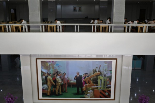 A giant painting of North Korean's later leader Kim Il Sung (center) is on display at the Kim Chaek University of Technology in Pyongyang, North Korea on Thursday, Sept. 20, 2012. The university was founded in 1948 and its digital e-library was created in 2005.