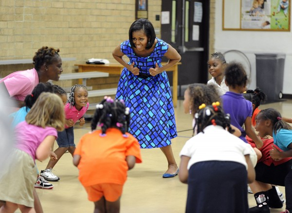First lady Michelle Obama does a little dance with students in the afternoon school program at the Girls Place in Gainesville, Fla., Monday, Sept. 17, 2012.