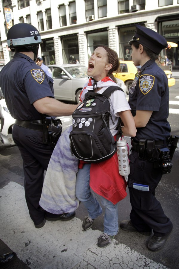 Police take Amanda Lodoza, an activist associated with the Occupy Wall Street movement, into custody during a march in New York, Sunday, Sept. 16, 2012. The Occupy Wall Street movement will mark its first anniversary Monday.