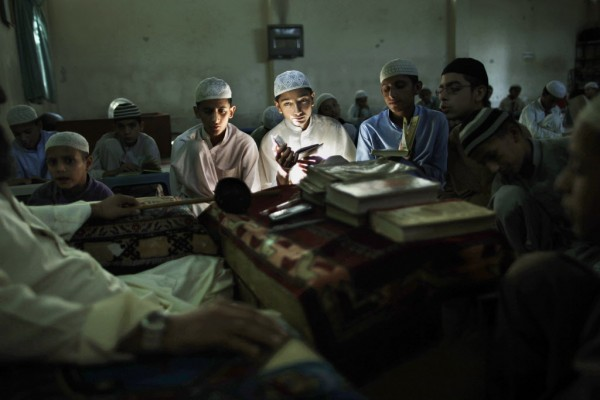 Pakistani students of a madrassa, or Islamic school, attend a test in reciting verses of the holy Quran, in a mosque in Islamabad, Pakistan, Wednesday, Sept. 26, 2012.