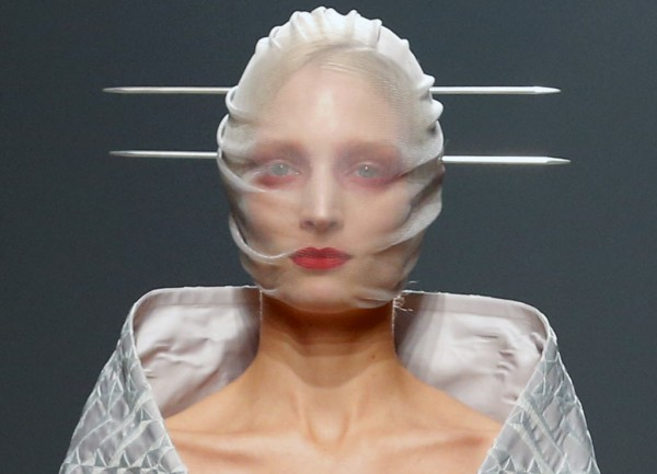 A model wears a creation by British fashion designer Gareth Pugh for the fashion house's Spring Summer 2013 ready to wear collection, during Fashion Week, in Paris, Wednesday, Sept. 26, 2012.