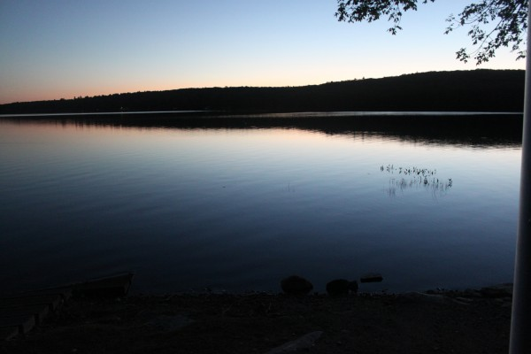 The sky glows at sunset over Pattee Pond, seen from the boat launch at Camp Caribou in Winslow, Maine, on Sept. 14, 2012, the first day of the Becoming an Outdoors-Woman (BOW) Introductory Skills Weekend.