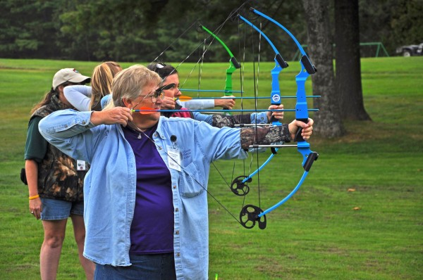 Participants in the Becoming an Outdoors-Woman introductory skills weekend are learning archery skills during September 2009 at Camp Caribou in Winslow, Maine.