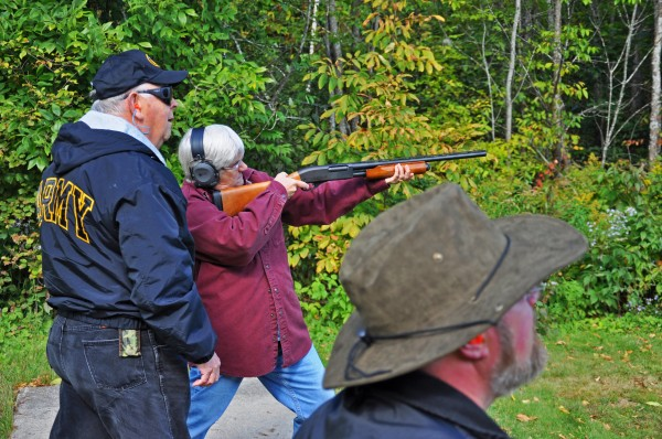 Participants in the Becoming an Outdoors-Woman introductory skills weekend learn firearm skills during September 2009 at Camp Caribou in Winslow, Maine.