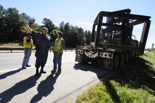 Maine State Trooper Phil Pushard (left) talks with Ronald Bealieu, a truck driver with Owen J. Folsom, Inc., whose forklift and steel frame payload hit the Union Street overpass around 11:30 a.m. Thursday, Sept. 20, 2012.