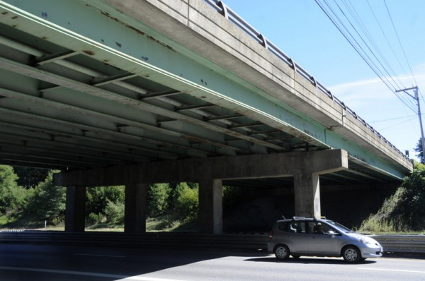 A noticeable bow in the outside beam of the Union Street bridge can be seen above a car on I-95 southbound around noon Thursday, Sept. 20, 2012.