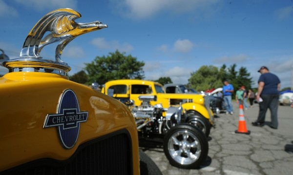 People walk around to look at the vehicles displayed during the Brewer Days car show at the parking lot of the Brewer Auditorium on Sept. 13, 2009. Vehicles in several categories and vintages from the 1930s to today were on display for car enthusiasts.