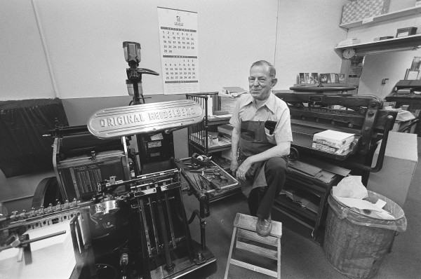 Thomas Watson Sr. poses with his equipment for a BDN story in 1991 in observance of his 50 years in business.