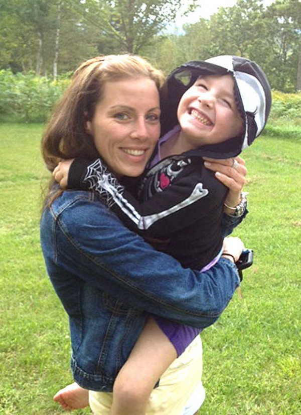 Brooke Bilodeau, a nurse, holds Danika DeMayo, 5, of Woodstock. Danika's mother, Amy Liberman, credits Bilodeau with saving Danika's life when she stopped at the scene of the accident to render aid.