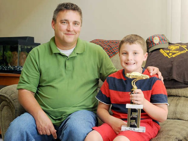 Christopher Tiner, 9, of Minot quit Cub Scouts because of the Boy Scouts of America's prohibition on openly gay Scouts and leaders. &quotI didn't think it was fair,&quot said the former Pack 139 Scout. He won a trophy at the Pinewood Derby in March.