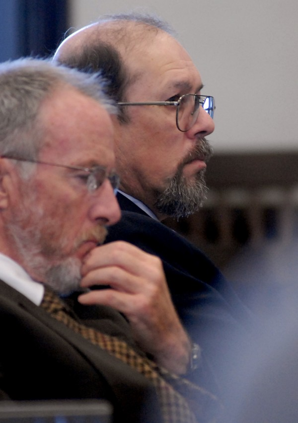 Jay Mercier (right) listens to opening arguments at the start of his trial in the murder of Rita St. Peter in 1980.