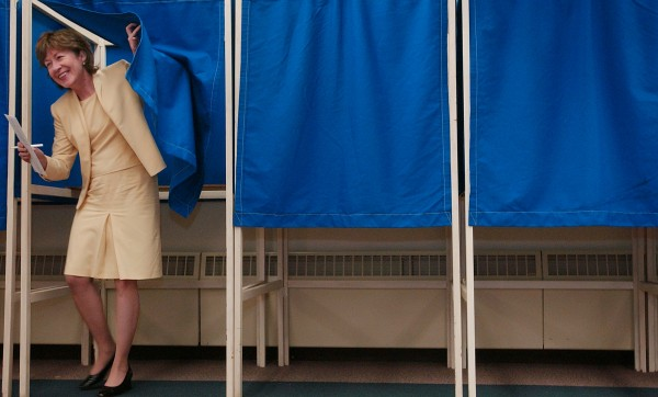 Sen. Susan Collins, R-Maine, emerges from a voting booth Wednesday, May 31, 2006, after casting an absentee ballot for the June primary at the Bangor Civic Center in Bangor, Maine. Collins, who said she would be away in Washington on Election Day, was the 12th person to vote at this new early voting venue.