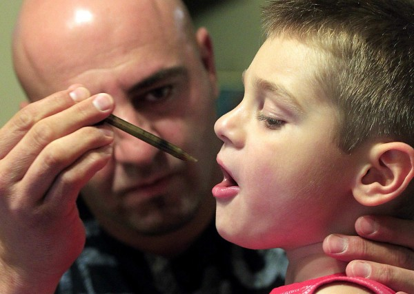 Jason David administers oral drops of a medical marijuana tincture that he says has greatly helped control the symptoms of his son Jayden's severe epilepsy in Modesto, California, July 20, 2012.