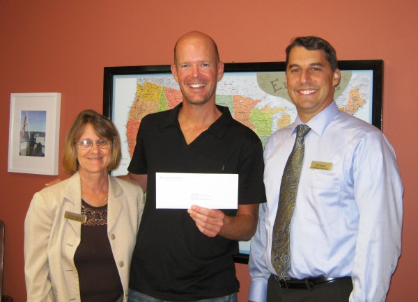 Trekkers' Executive Director Don Carpenter receives a check from 