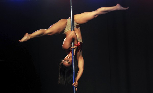 Pole dancer Sandra Toro strikes a pose as she performs at the Miss Pole Dance Colombia 2012 contest in Medellin, Colombia, Friday, Sept. 28, 2012. Toro won the competition.