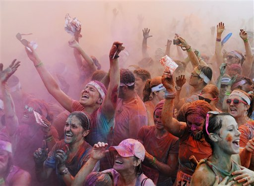 People participate in the 5K Color Run Birmingham at Barber Motorsports Park in Leeds, Ala., Monday, Sept. 3, 2012. The run helped benefit The Arc Jefferson County.