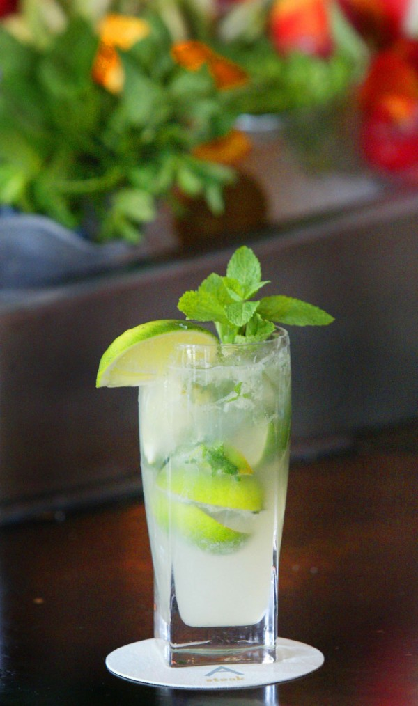 You probably know by now that sipping a mojito or margarita can rack up as many calories as a drive-through cheeseburger. You may not realize, however, that you're doing double the damage when it's hot because warm weather tends to leave people somewhat dehydrated, which hinders the body's ability to burn fat and alcohol''s diuretic effect dries you out even more.