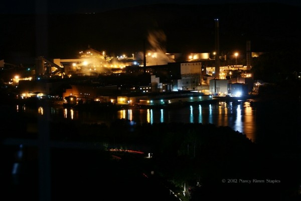 View of Verson Paper Mill in Bucksport from Penobscot Narrows Observatory in Prospect.  In the foreground, Fort Knox's main entrance ticket booth, lighted drive to the observatory and car tail lights are visible in this long exposure photo.
