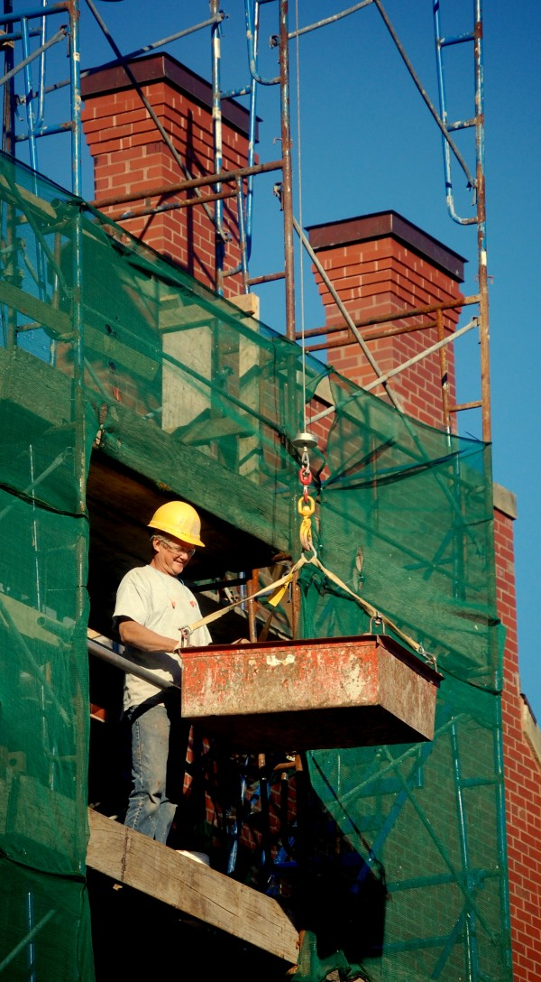 Restorations of 19th century commercial buildings along downtown Eastport's Water Street seem to be ongoing, weather-permitting. On Monday workers from G. Drake Masonry of Dixmont were busy repairing the brick facade of the three-story, 1887 building at 43-48 Water St. that now houses the Tides Institute & Studioworks.