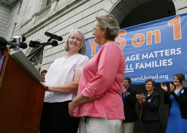 Sarah Dowling (left) smiles at Linda Wolfe, her partner of 18 years, as she speaks Monday, Sept. 10, 2012 at a rally outside of City Hall in Portland in support of a ballot question that seeks to legalize same-sex marriage.