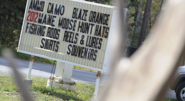 Gateway Variety in Ashland is a one-stop shop for food and outdoor gear, including hunting attire, as seen on their roadside sign. This popular northern Maine game inspection station was bustling with hunters on the first day of moose hunting season as 22 moose were tagged there by noon Monday, Sept. 24, 2012.