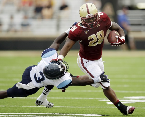 Boston College running back Rolandan Finch (28) shakes a tackle from Maine defensive back Darlos James (3) during the second half of an NCAA college football game at Alumni Stadium in Boston, Saturday, Sept. 8, 2012. Boston College won 34-3