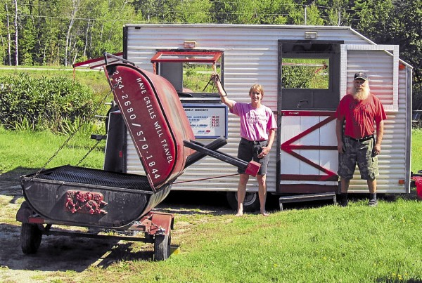 Jen and Stu Hatch show off one of their Mainely Cookouts cookers and their mobile kitchen at their Newburgh home.